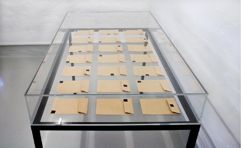 Cloud Chambers. Display case with 21 envelopes.
