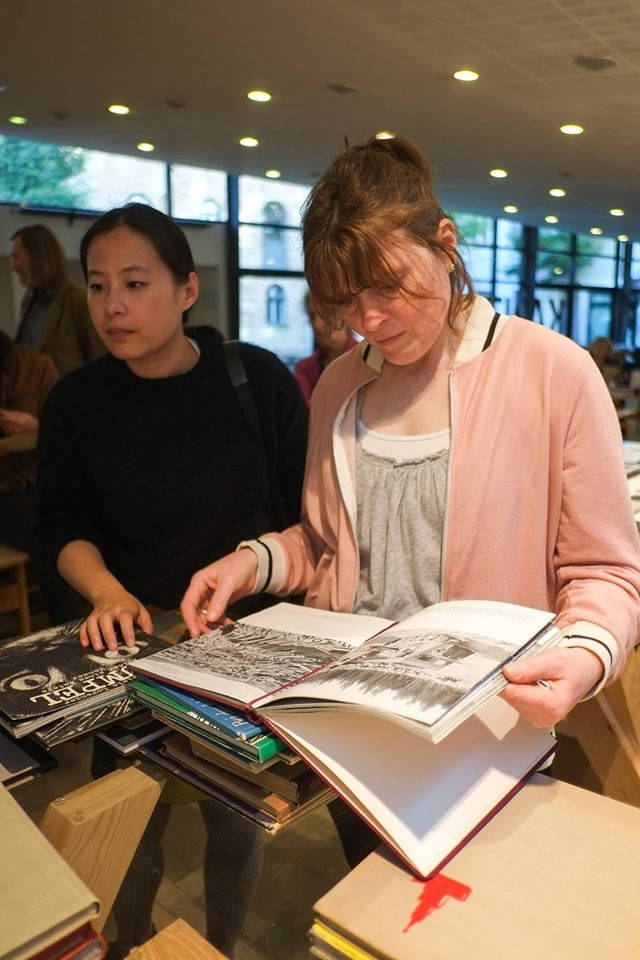Curator Yining He and photographer Miriam O'Connor at the book fair.